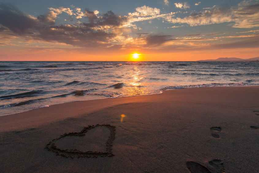 heart on the ocean beach sunset